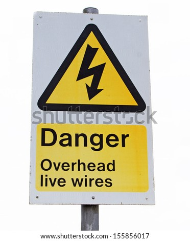 A sign warning that there are live wires above you - stock photo