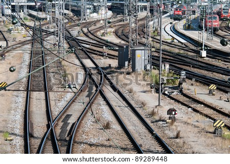 a signal box with many rails and trains - stock photo