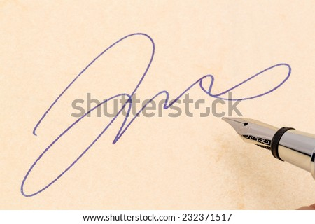 a signature and a fountain pen on yellow paper. photo icon for contract testament and graphology - stock photo