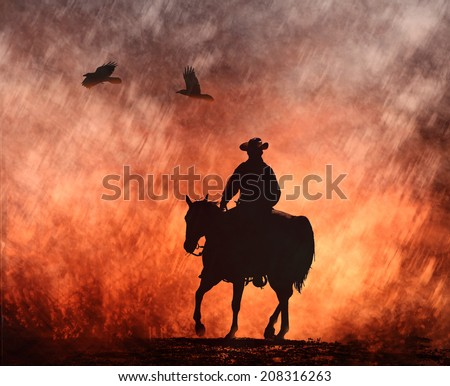 A silhouette of a cowboy on his horse rides into the fire with birds flying above. - stock photo