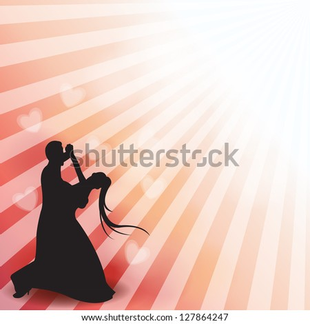 a silhouette of a dancing couple - stock photo