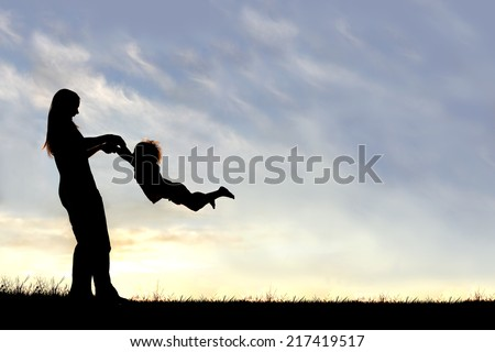 A silhouette of a playful young mother spinning and dancing with her little child outside at sunset on a summer day. - stock photo