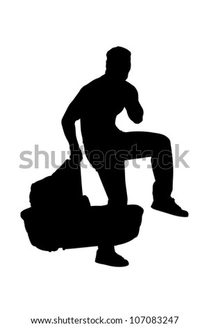 A silhouette of a robber holding a carrycot isolated on white background - stock photo