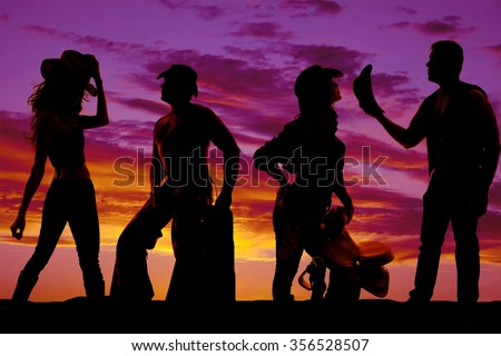 A silhouette of a some cowgirls and cowboys being together. - stock photo