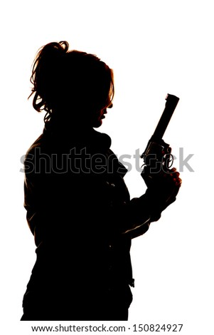 A silhouette of a woman  holding on to her pistol. - stock photo