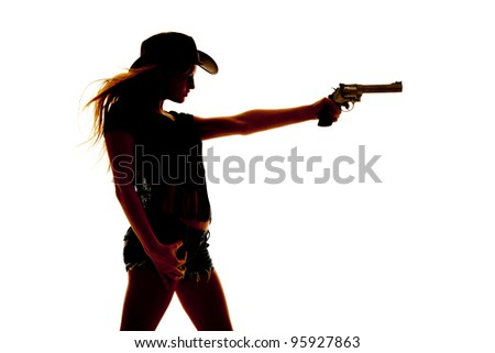 a silhouette of a woman holding out a pistol. - stock photo