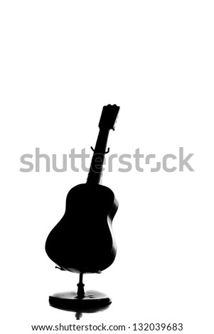 A silhouette of an acoustic guitar isolated on white background - stock photo