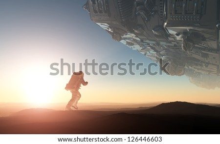 A silhouette of an astronaut in sunlight. - stock photo