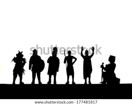 a silhouette of toy warriors on a clean background - stock photo