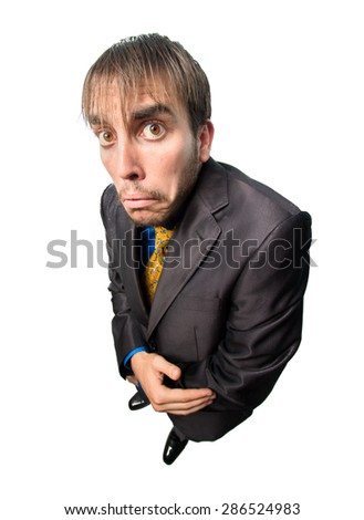 A silly guy in a suit , looking scared isolated on white background - stock photo