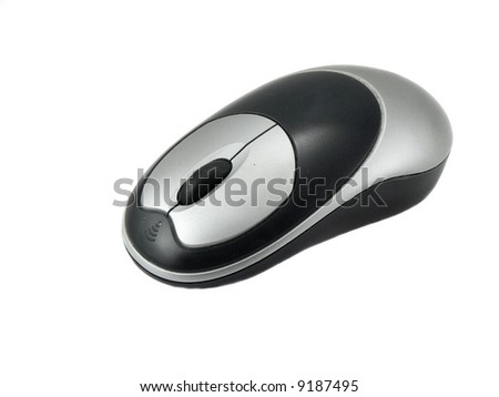 A silver and black, wireless computer mouse. - stock photo