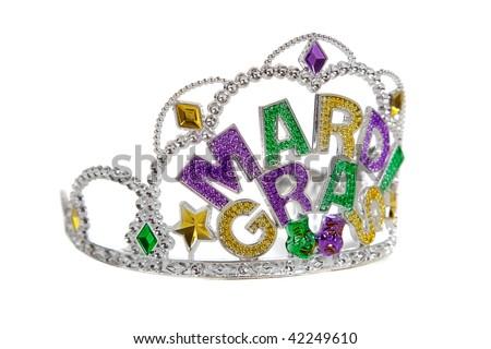 A silver, gold, purple and green mardi gras tiara on a white background - stock photo
