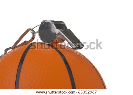 A silver whistle laying on an orange basketball. Add your text to the background. - stock photo