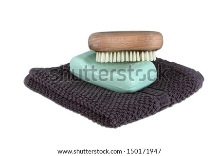 A simple mans face wash collection isolated over white.  Includes face cloth, bar of soap, and a scrub brush. - stock photo