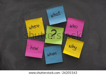 a simple mind map with questions (what, when, where, why, how, who)  to solve a problem posted with colorful sticky notes on blackboard - stock photo