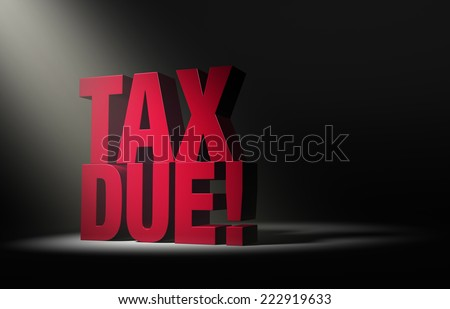 "A single, angled spotlight reveals a large, red ""TAX DUE!"" on a dark background. - stock photo"