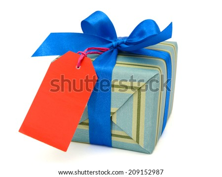 A single gift box and tag - stock photo