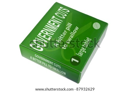 A single green medication package with the words 'government cuts a bitter pill to swallow' arranged over white. - stock photo