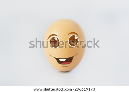 A single happy eggs with smiling faces representing emotional happiness. Isolated on a white background - stock photo