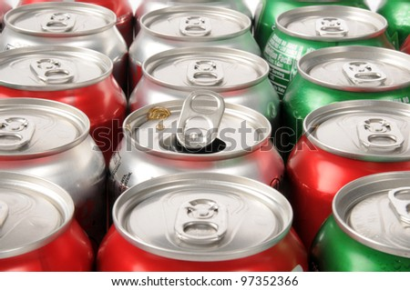 A single opened soft drink can in rows of drinks - stock photo