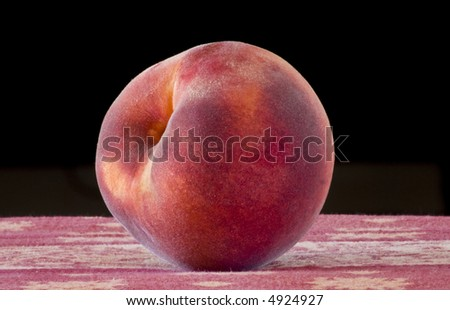 A single peach. - stock photo