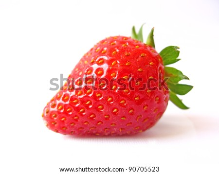 A single red strawberry isolated in white - stock photo