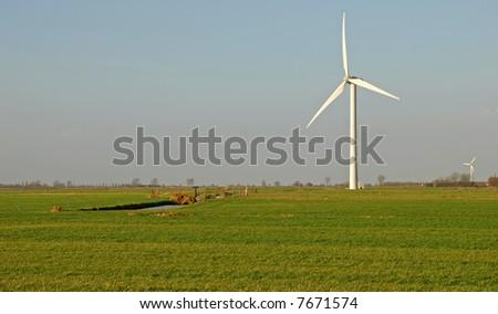 A single wind turbine producing green energy - stock photo