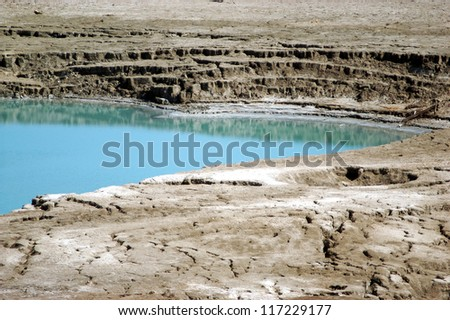A Sinkhole in The Dead Sea valley Israel. - stock photo