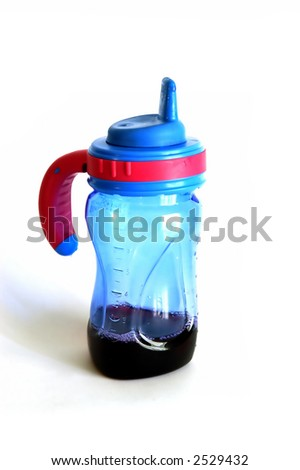 A Sippy Cup isolated against a white background - stock photo