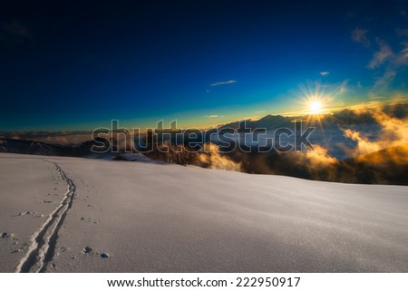 A ski trail during sunset - stock photo