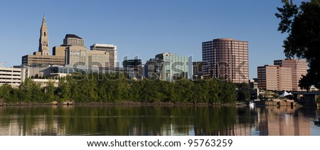 A skyline and riverfront view of Hartford CT during summer - stock photo