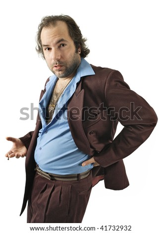 A sleazy car salesman, Con man, retro suit wearing man with bizarre facial expression. - stock photo