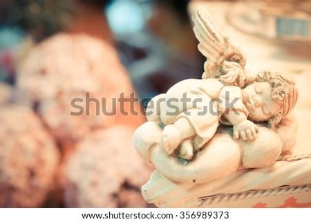 A sleeping cupid - stock photo