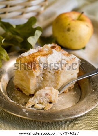 A slice of apple cake and cup of tea. Soft focus - stock photo