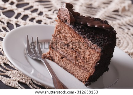 slice of chocolate truffle cake on a plate on a table close-up ...