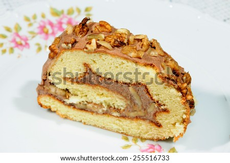 A slice of homemade Swiss roll - stock photo