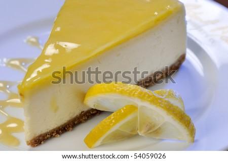 A slice of lemon cheesecake. - stock photo