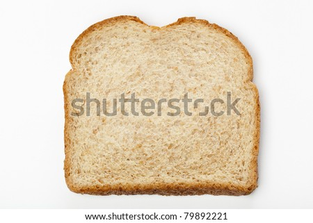 A slice of whole wheat bread against a white background - stock photo