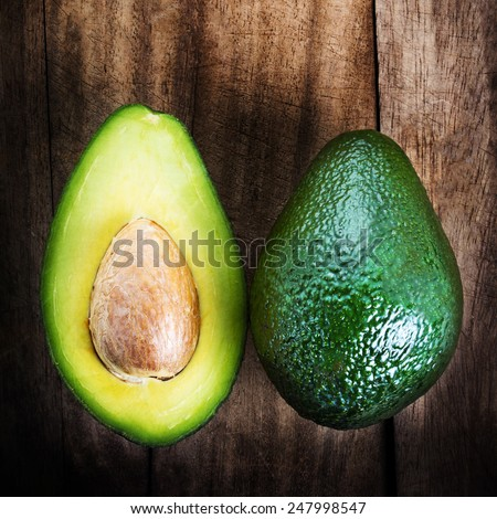 A sliced avocado on a cutting board closeup. fresh ,green avocado - stock photo