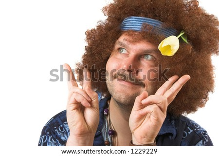 A slightly too old hippie making the peace sign with a tulip in his hair - stock photo