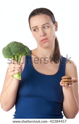 A slimming woman being tempted to stray from her diet. - stock photo