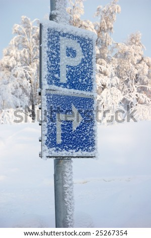 A slippy winterroad in northern Sweden gällivare and parkingsigns. - stock photo