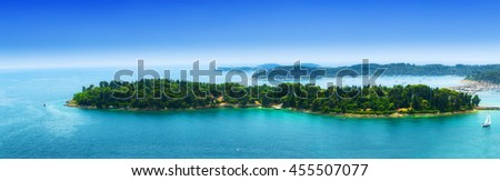 a small archipelago green islands in the calm sea in warm summer day - stock photo