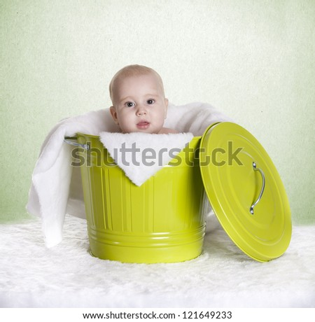 a small baby, in a bucket - stock photo