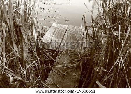 A small bridge in sepia - stock photo