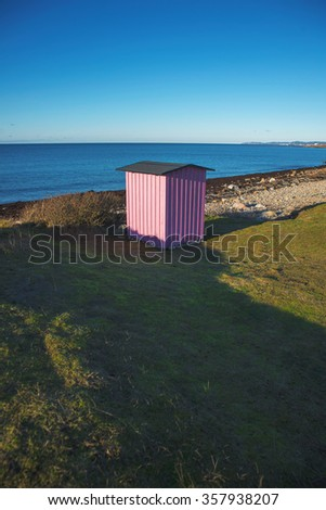 a small building on the beach - stock photo
