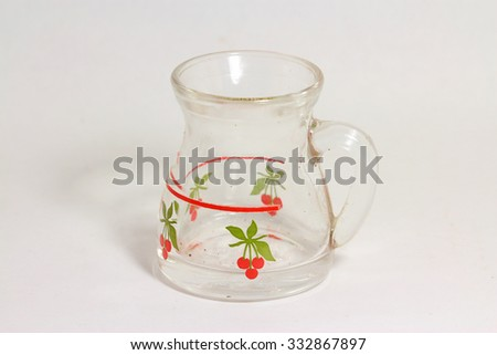 A small carafe with drawn cherries, white background - stock photo
