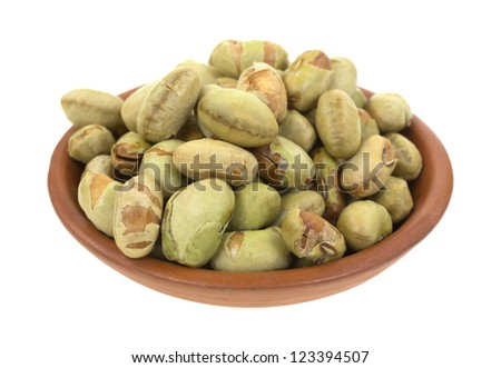 A small clay bowl filled with edamame soybeans on a white background. - stock photo