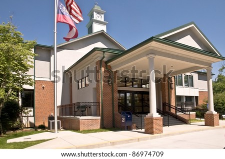 A small county courthouse office building with new entrance addition. - stock photo