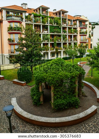 A small courtyard with a beautiful gazebo in Milan, Italy. - stock photo